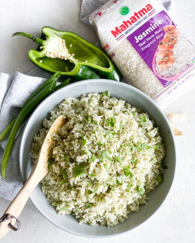 Want a super easy side dish that pairs perfectly with almost everything?! {ad} Look no further and make my Instant Pot Green Rice ASAP.   I took @mahatmariceusa Jasmine Rice on a fun, flavor packed adventure by infusing it with flavor boosters such as cilantro, poblano pepper, garlic and green onion. Enjoy the sweet and savory aroma as the rice cooks in an Instant Pot. In about 10 minutes, you'll be rewarded with soft, fluffy Green Rice that you'll want to eat by the spoonful!  Mahatma® Jasmine Rice is traditionally grown in Thailand. This variety is a long grain rice with an aromatic, floral and exotic flavor that cooks up moist with a soft texture. Grab a bag, a few ingredients and get cookin'!  Instant Pot Green Rice  2 cups uncooked Mahatma® Jasmine Rice 1 cup roughly chopped cilantro leaves 1/2 cup sliced poblano pepper 3 stalks green onions sliced 3 garlic cloves 2 1/4 cups water  Purée cilantro, pepper, green onion, garlic and 1/4 cup water in a food processor.  Rinse Mahatma® Jasmine Rice and place it in an instant pot. Pour the remaining 2 cups of water and mix in the puréed herbs. Cook using the rice setting for 10mins. Do a quick pressure release and fluff rice before serving.   @KrogerCo @ralphsgrocery #mahatmariceatkroger